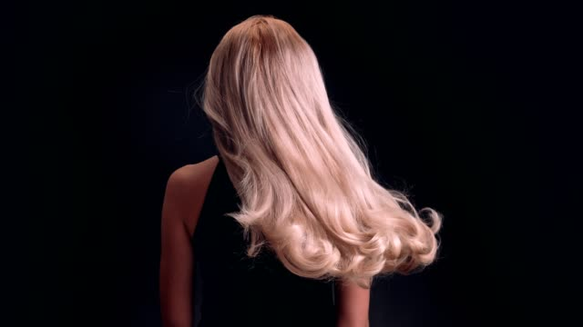 beautiful blond woman tossing her long, wavy hair - hair straighteners stock videos and b-roll footage
