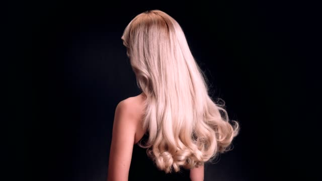 beautiful blond woman tossing her long, wavy hair - long stock videos & royalty-free footage