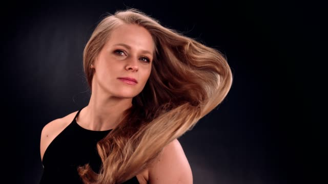 beautiful blond woman tossing her long, wavy hair - swinging stock videos & royalty-free footage