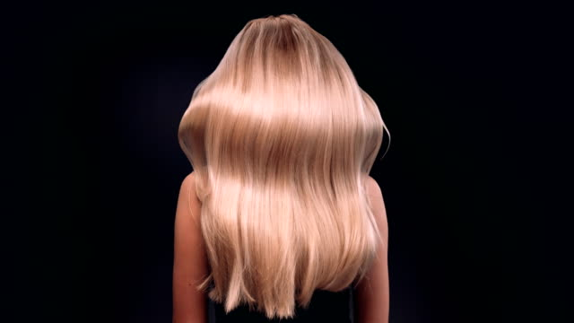beautiful blond woman tossing her long, wavy hair - straight hair stock videos & royalty-free footage