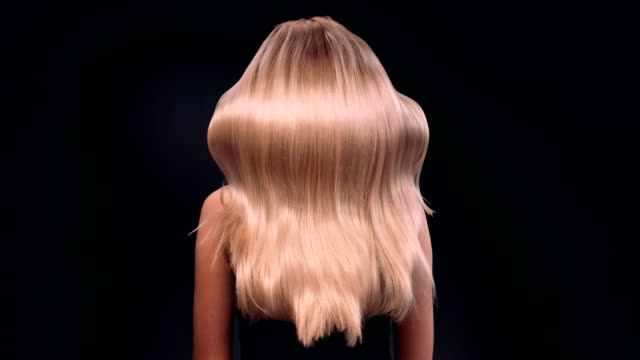 beautiful blond woman tossing her long, wavy hair - long hair stock videos and b-roll footage