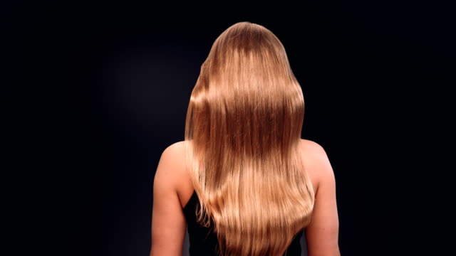 beautiful blond woman tossing her long, wavy hair - hair treatment stock videos and b-roll footage