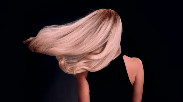 beautiful blond woman tossing long hair - hairstyle stock videos & royalty-free footage