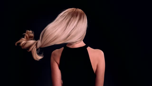beautiful blond woman tossing long hair - straight hair stock videos & royalty-free footage