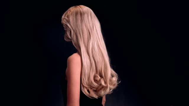 beautiful blond woman tossing long hair - hair toss stock videos & royalty-free footage