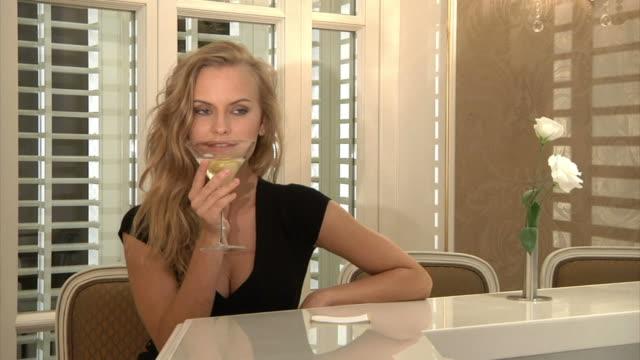 Beautiful Blonde Drinking and Flirting