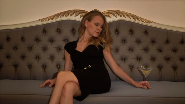 beautiful blonde drinking and relaxing - cross legged stock videos & royalty-free footage