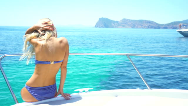 Beautiful blonde girl in bikini in Yatch