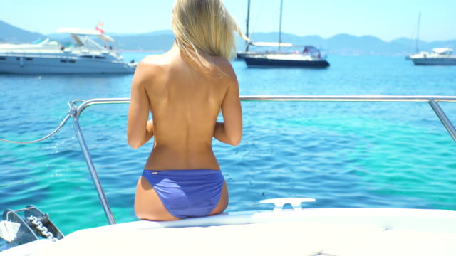 beautiful blonde girl in topless in yatch - naked stock videos and b-roll footage
