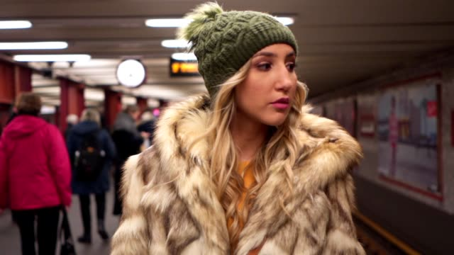 beautiful blonde girl walking through subway station - subway train stock videos & royalty-free footage