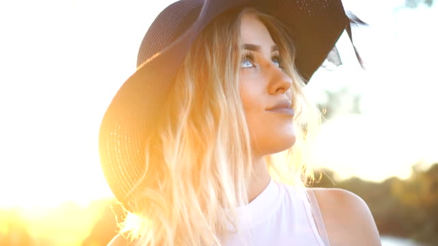 beautiful blonde girl with summer hat - hat stock videos & royalty-free footage