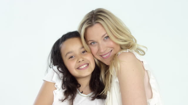 beautiful blonde haired mother with her cute dark haired daughter - portrait and having fun - mother and daughter making out stock videos & royalty-free footage
