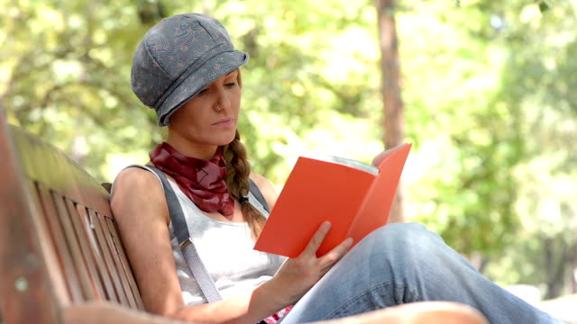 beautiful blonde hipster woman reading a book - wasting time stock videos & royalty-free footage
