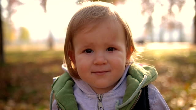beautiful blonde little boy looking at the camera - baby boys stock videos & royalty-free footage
