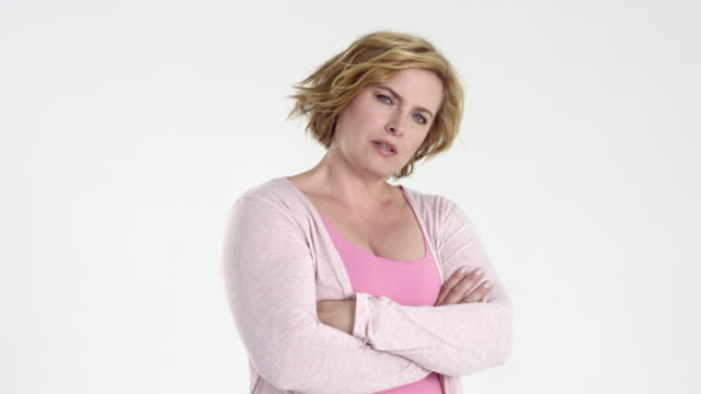 beautiful blonde plus size / best age model posing - various facial expressions