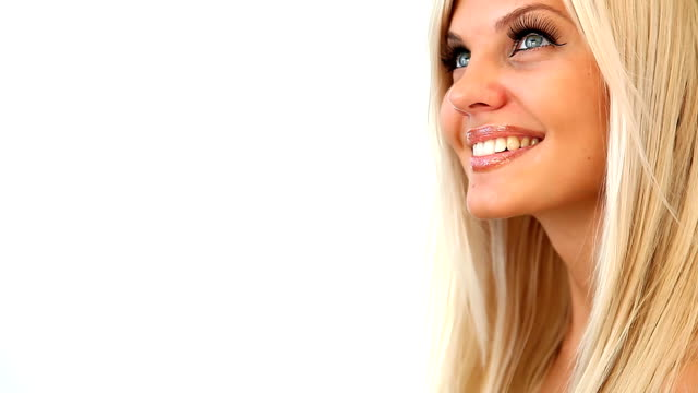 beautiful blonde woman dreaming and smiling - blonde hair stock videos & royalty-free footage