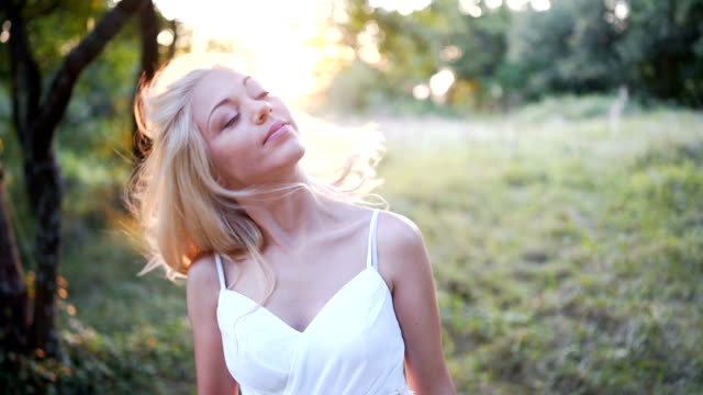 beautiful blonde woman outdoors - lawn stock videos & royalty-free footage