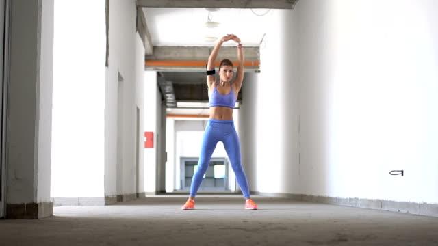 beautiful blonde woman stretching - sweatshirt stock videos and b-roll footage