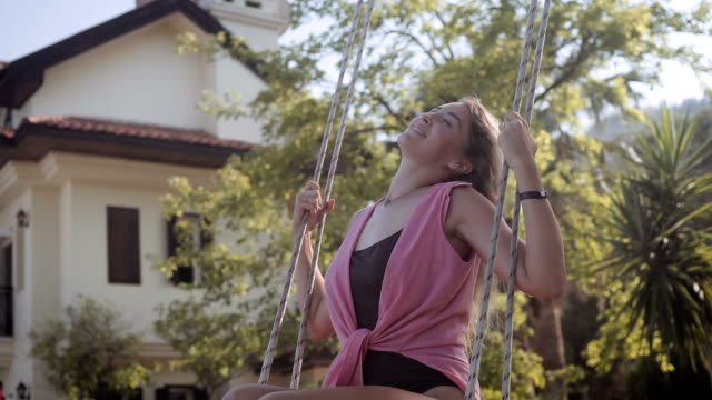 beautiful blonde woman swinging - swinging stock videos & royalty-free footage