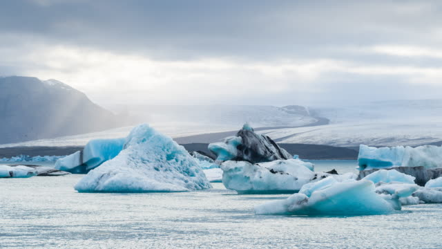 beautiful blue ice of icebergs in jokulsarlon glacial lake - conditions stock videos and b-roll footage