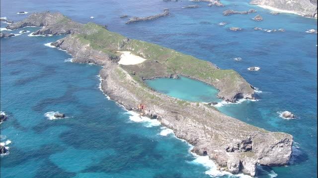 beautiful blue waters surround minamijima island - subtropical climate stock videos and b-roll footage