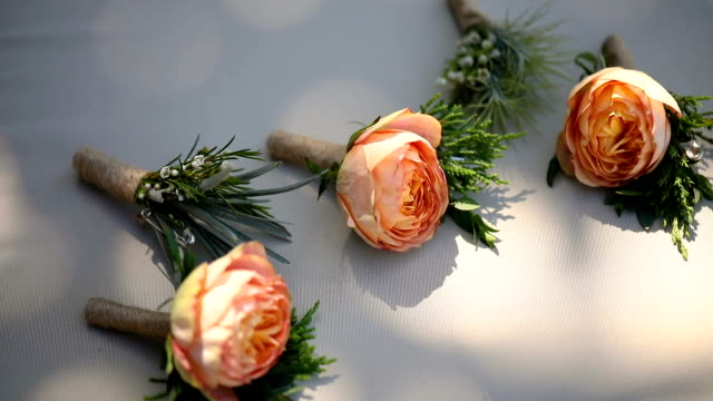 Beautiful boutonniere of the groom and groomsman.