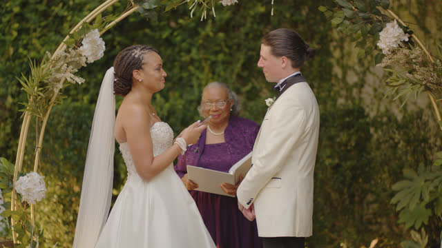 beautiful bride presents heartfelt vows to the bridegroom - wedding vows stock videos & royalty-free footage