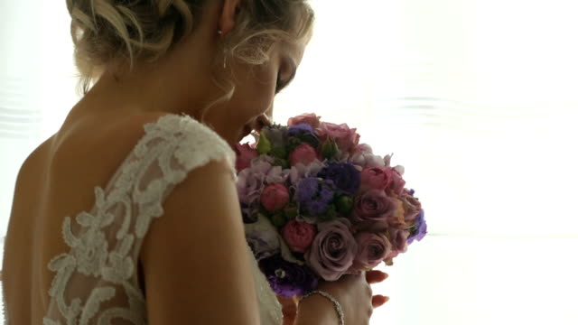 beautiful bride smells her biedermeier - wedding ceremony stock videos & royalty-free footage