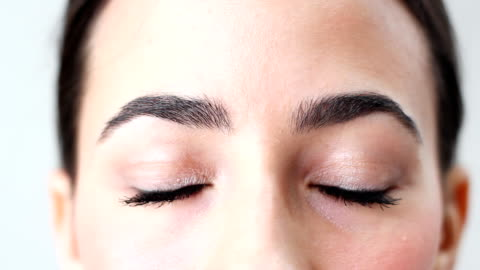 beautiful brown woman's eyes - eyelash stock videos & royalty-free footage