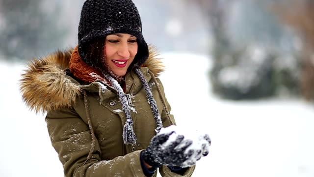 Beautiful Brunette Girl Making A Snow Globe