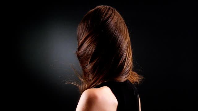 Beautiful brunette tossing her long hair