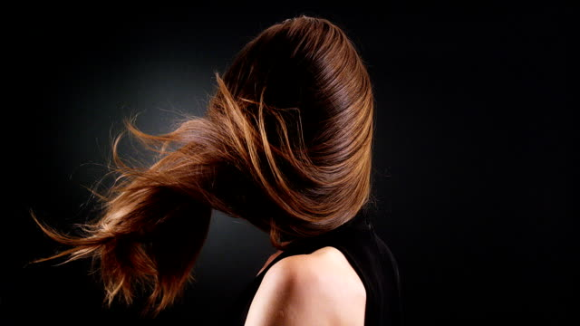 beautiful brunette tossing her long hair - human hair stock videos & royalty-free footage