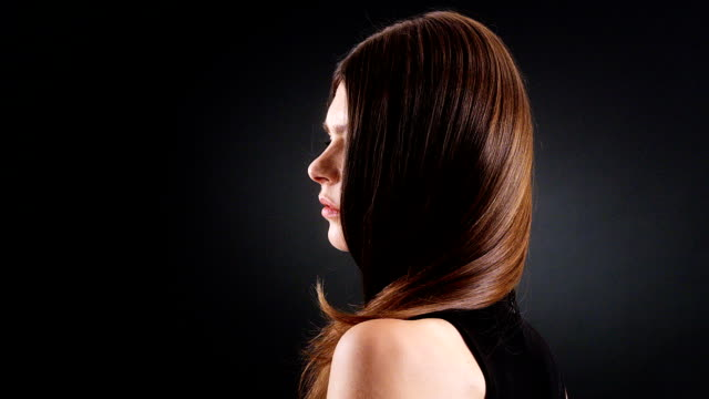 beautiful brunette tossing her long hair - straight hair stock videos & royalty-free footage