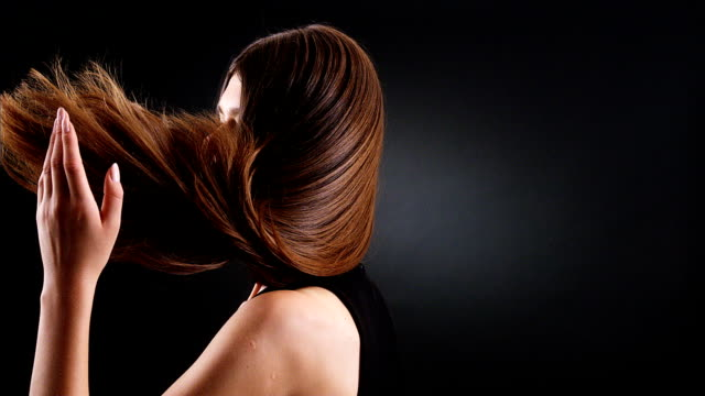 beautiful brunette tossing her long hair - brown hair stock videos & royalty-free footage