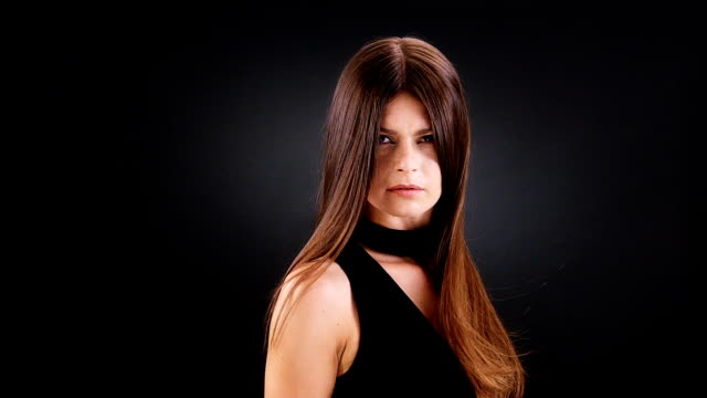 beautiful brunette tossing her long hair - hair straighteners stock videos and b-roll footage