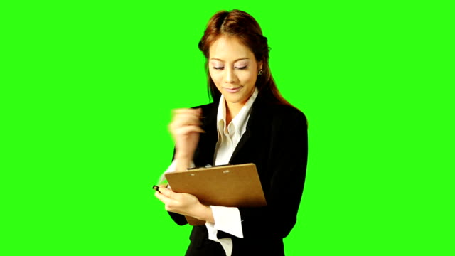 beautiful business woman having an idea and taking a note - keyable stock videos & royalty-free footage