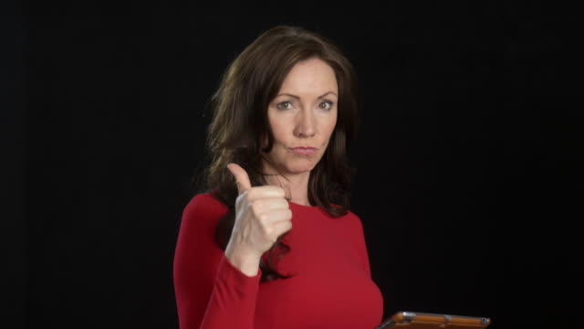 beautiful business woman (45 years old) in red dress - multiple facial expressions with iPad