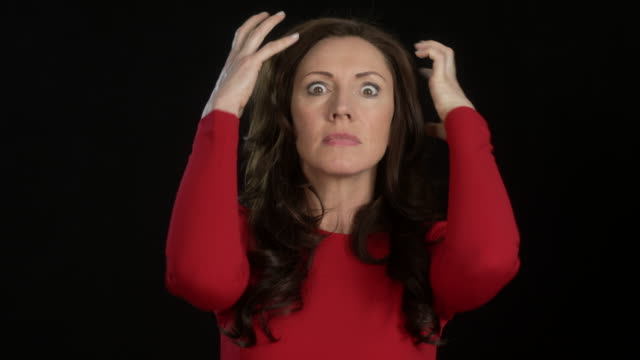 beautiful business woman (45 years old) in red dress - multiple intense facial expressions - frustration/anger