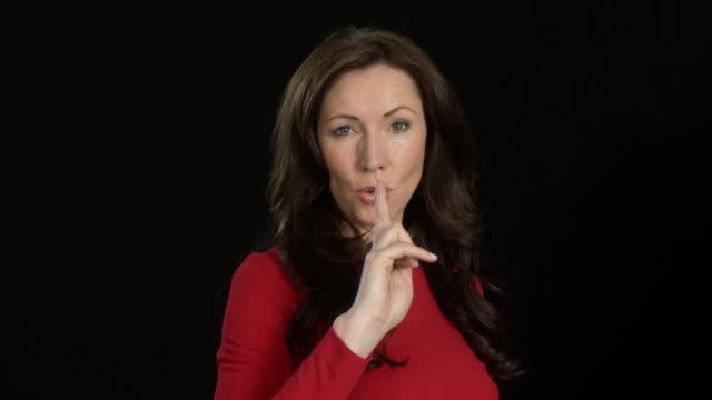 beautiful business woman (45 years old) in red dress - multiple intense facial expressions - convincing - 45 49 år bildbanksvideor och videomaterial från bakom kulisserna