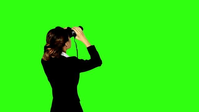 beautiful business woman looks to the future through binocular - binoculars stock videos & royalty-free footage