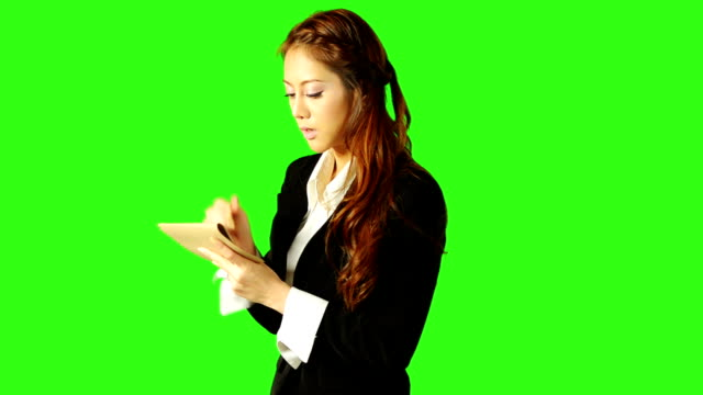 beautiful business woman taking a note with green screen background - keyable stock videos & royalty-free footage