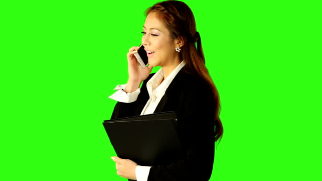 beautiful business woman talking telephone and holding a file - keyable stock videos & royalty-free footage