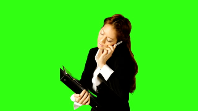 stockvideo's en b-roll-footage met beautiful business woman talking telephone and taking a note - keyable