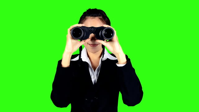 beautiful business woman with binocular on green screen background - binoculars stock videos & royalty-free footage