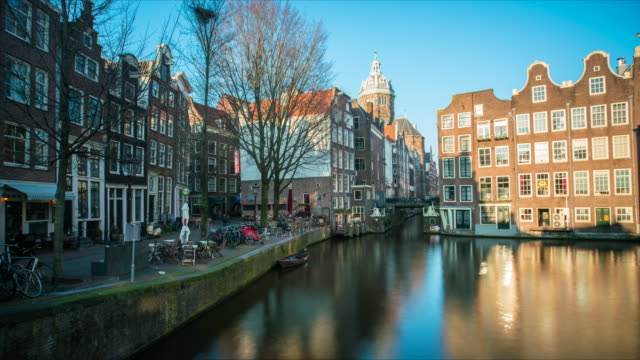 beautiful canal of amsterdam time lapse - silvestre stock-videos und b-roll-filmmaterial