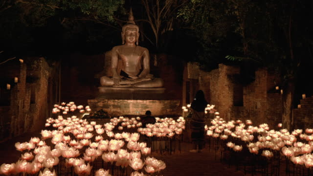 beautiful candle light with buddha statue - candlelight stock videos & royalty-free footage