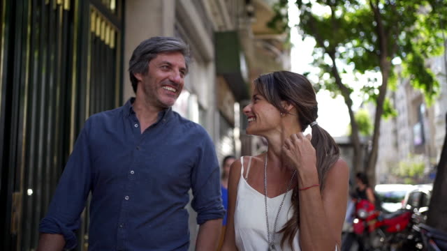 beautiful carefree couple walking in the city falling in love - flirting stock videos & royalty-free footage