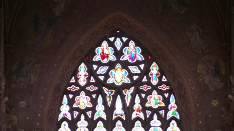 beautiful cathedral window, tilt to gold detail on ground, armagh, northern ireland - northern ireland stock videos & royalty-free footage