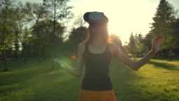 Beautiful caucasian woman enjoy virtual reality walking on grass in park