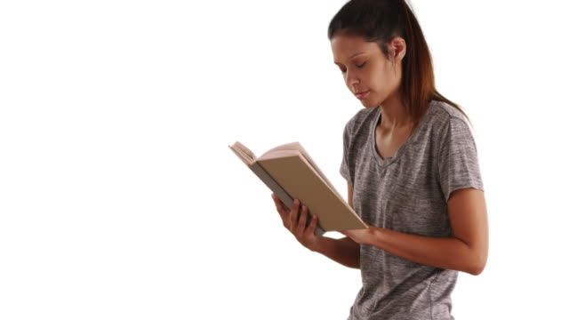 Beautiful Caucasian woman reading book on white background with copyspace